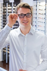 Man Trying On New Glasses At Opticians